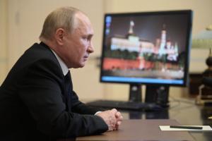 Alexey Druzhinin/Sputnik/AFP/Getty Images North America/TNS